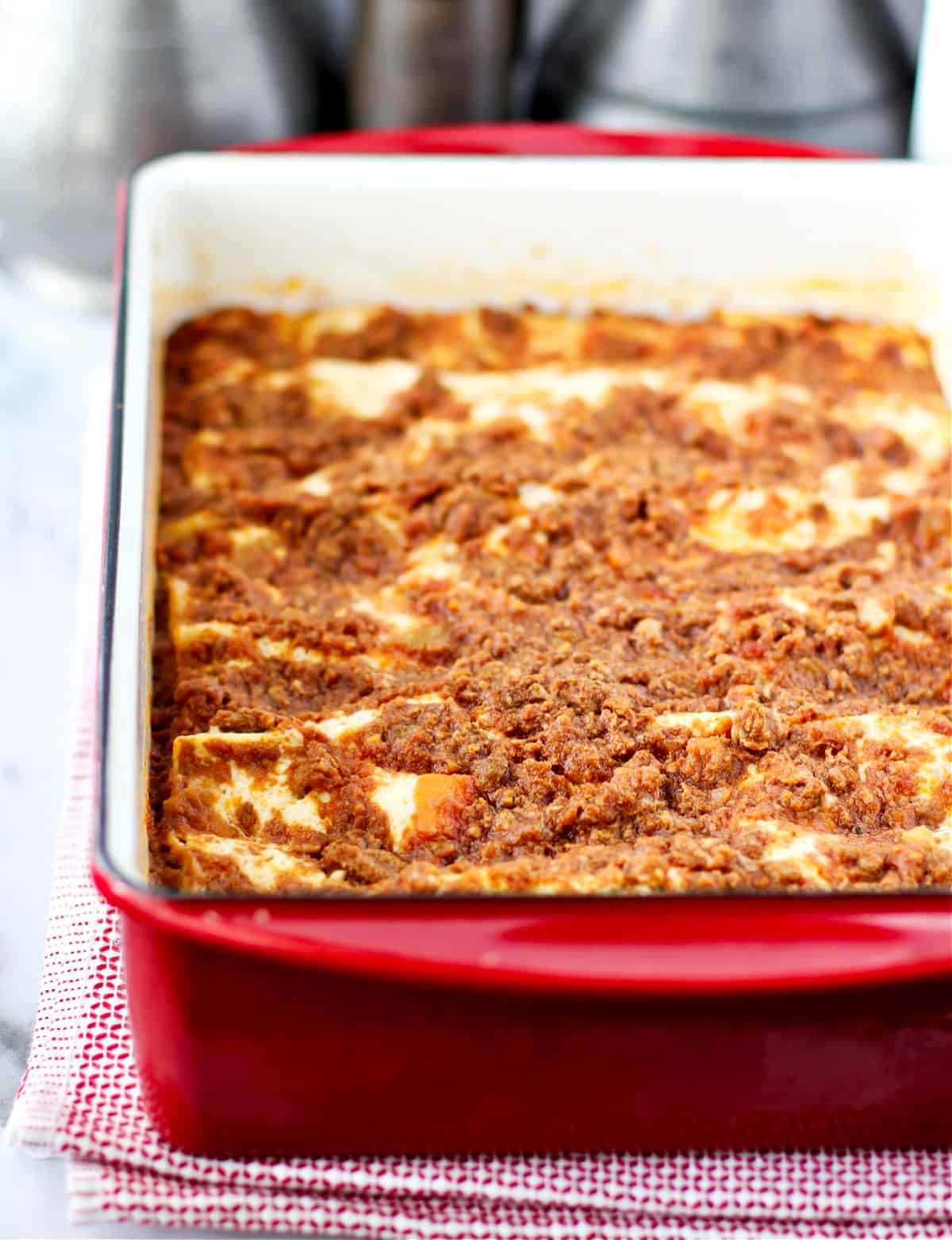Lasagna Bolognese in a baking pan.