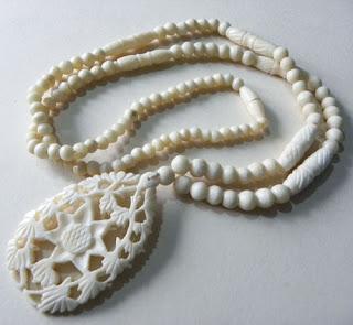 Faux bone pendant necklace of plastic