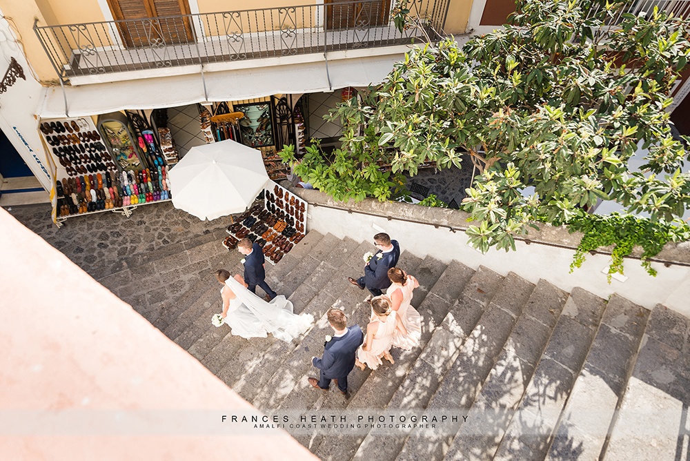 Bridal party walking down Positano streets