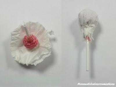Cabeza con chupa-chups de angel papel plegado