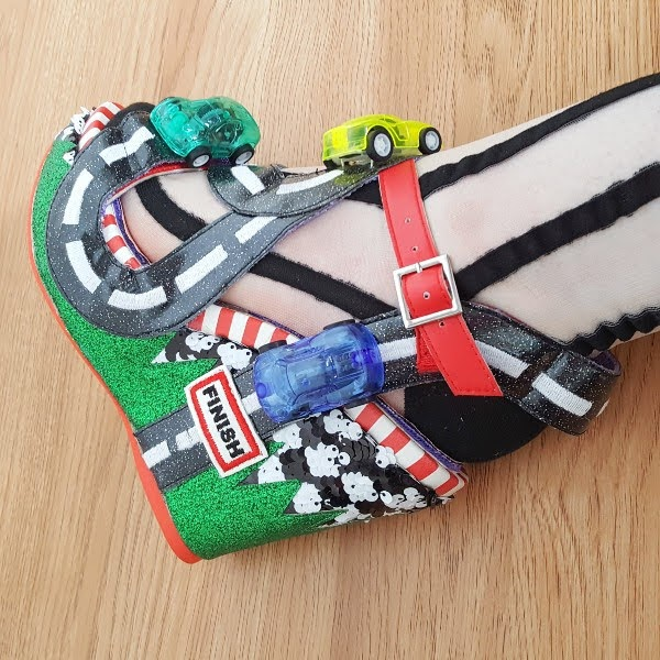 wearing mesh striped socks with road and racing car sandals
