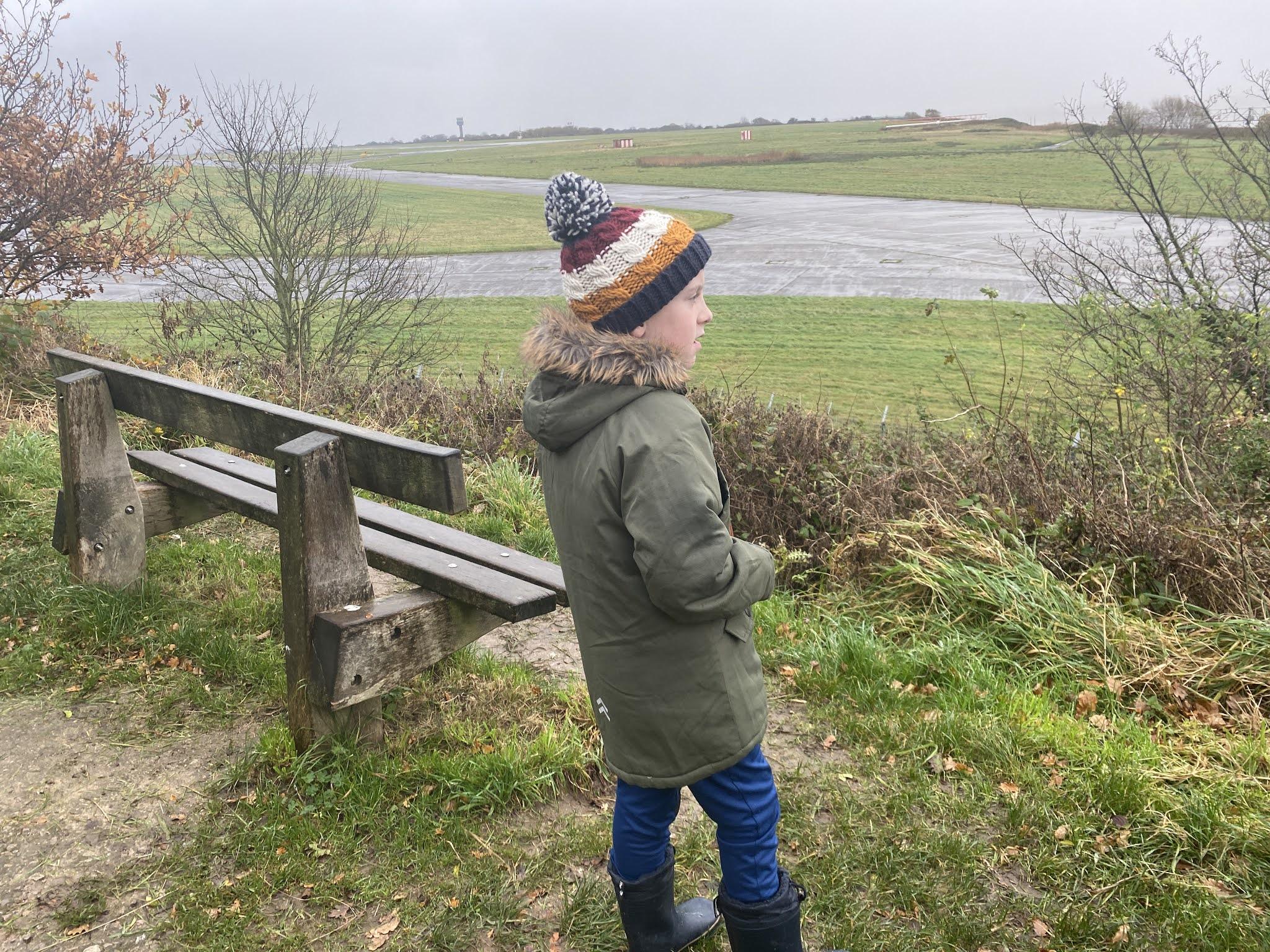 Boy overlooking a runway