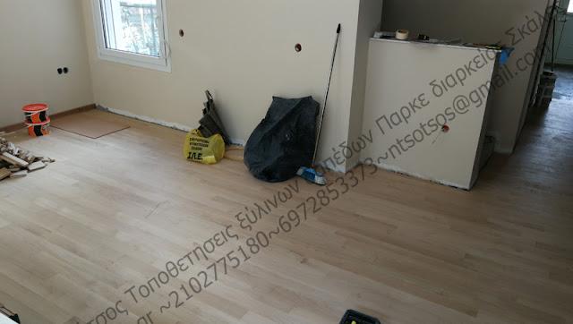 Κολλητό μασίφ ξύλινο πάτωμα πάνω σε τσιμεντοκονία