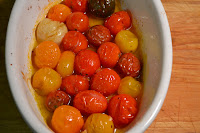 Burrata with roasted cherry tomatoes and garlic.