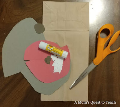 gray construction paper; red construction paper; glue stick; brown lunch bag; scissors