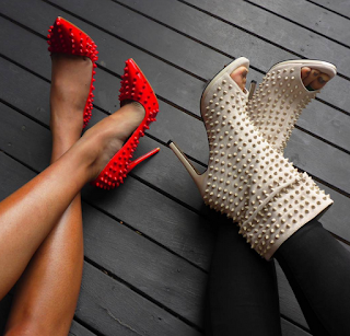 spiked red shoes and cream spiked boots