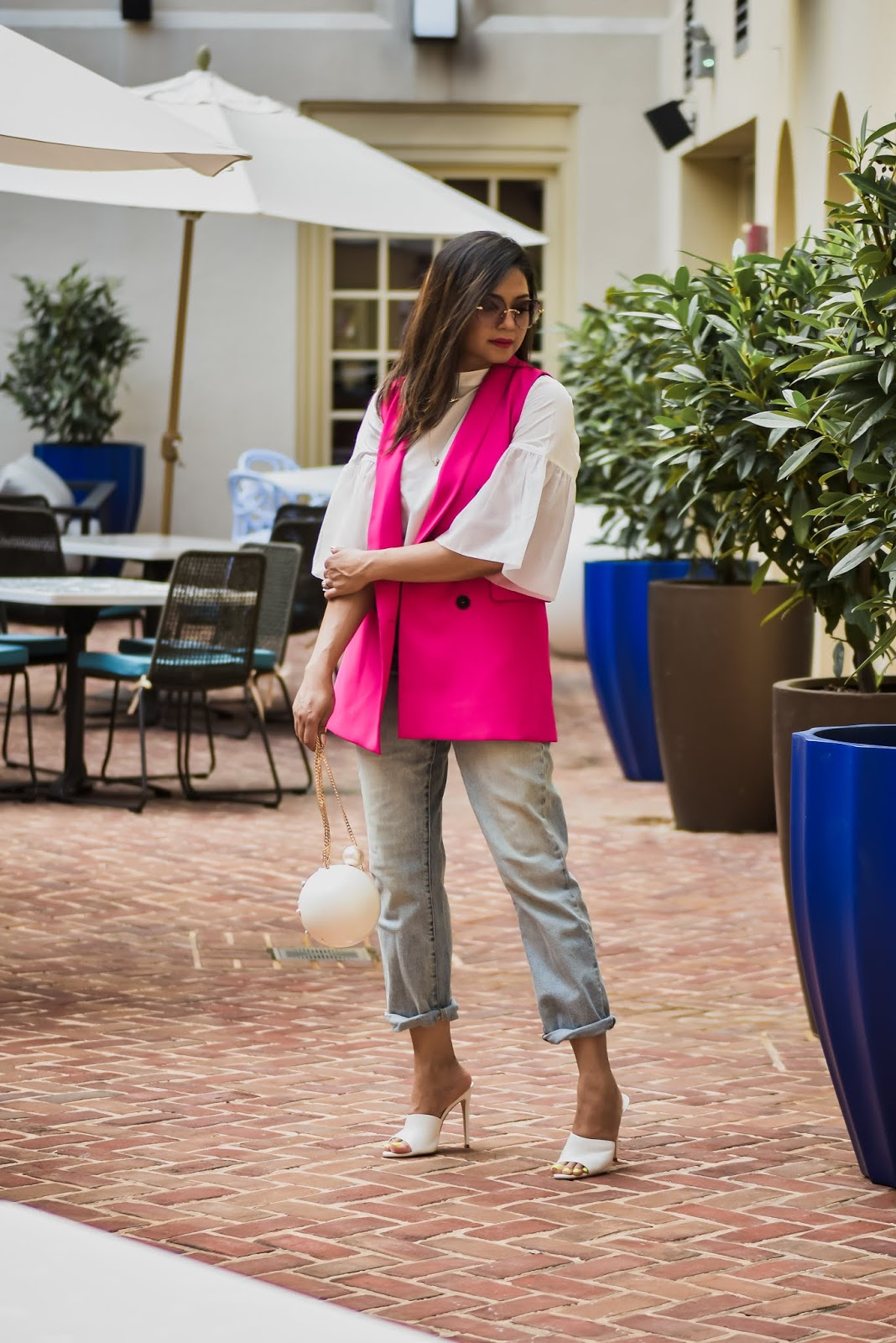 HOW TO STYLE A VEST two ways, pant suit, neon suit, pant wide leg, white ruffled blouse, fashion, street style, style inspiration, white mules, gucci marmont bag , myriad musings, saumya shiohare