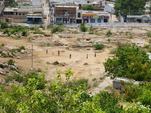 Views of Hyderabad India from Falaknuma Palace: children playing cricket