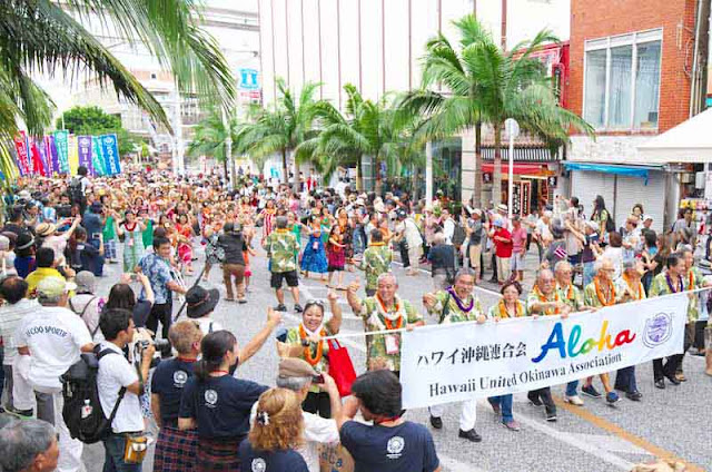 Okinawans from Hawaii marching on Kokusai Street, Naha