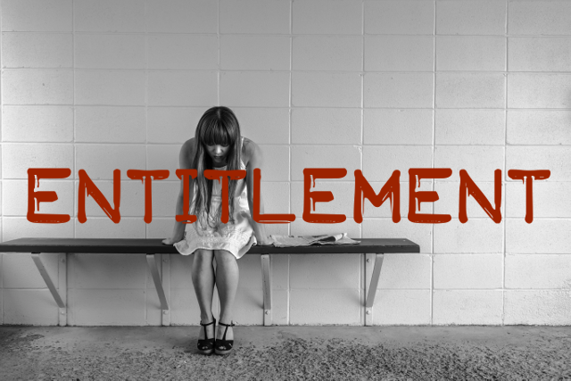 Image of a woman sat on a train-station platform with the word entitlement written on it.