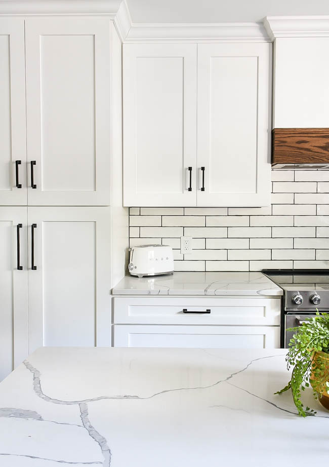 White kitchen cabinets with white tile