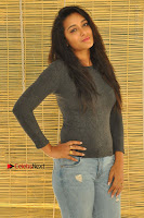 Actress Bhanu Tripathri Pos in Ripped Jeans at Iddari Madhya 18 Movie Pressmeet  0037.JPG