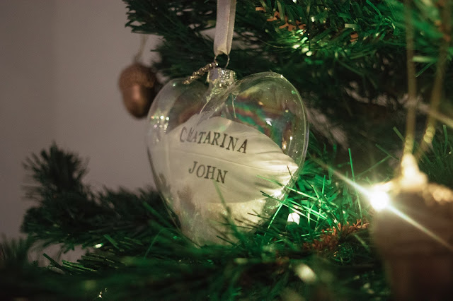 Personalised feather in a glass heart bauble decoration close up