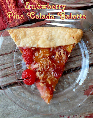 Strawberry Pina Colada Galette, a rustic tart made with strawberries, pineapple and more, a dessert version of a summer cocktail. | Recipe developed by www.BakingInATornado.com | #recipe #dessert