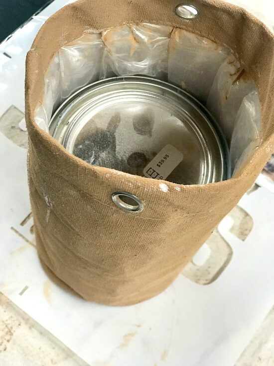 Using a quart of paint to stabilize the bag for painting.