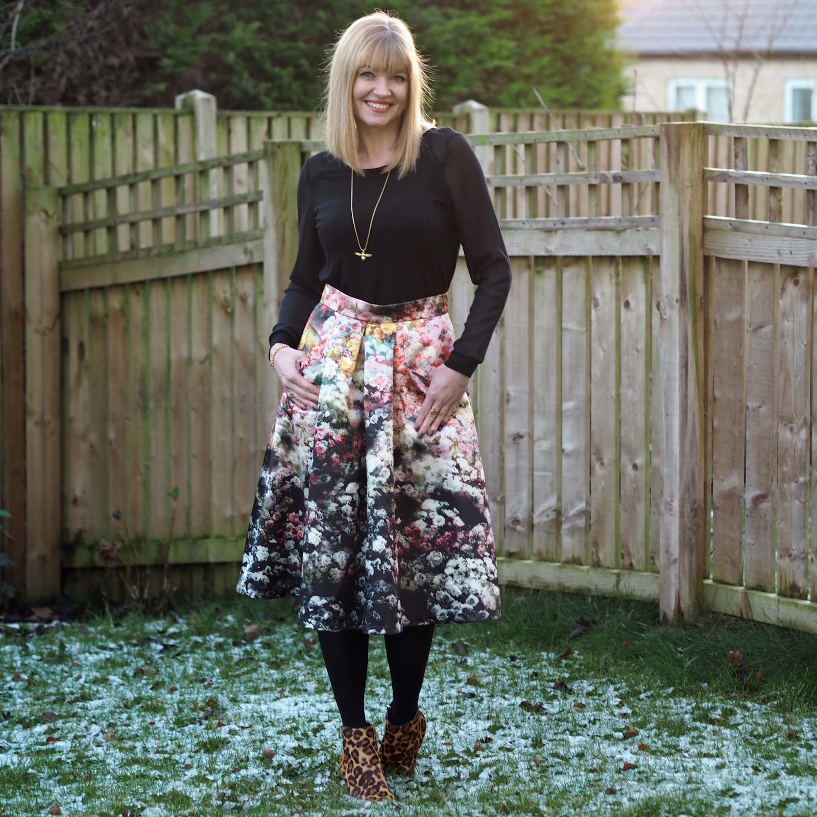 satin floral midi skirt with leopard print boots, over 40 style,