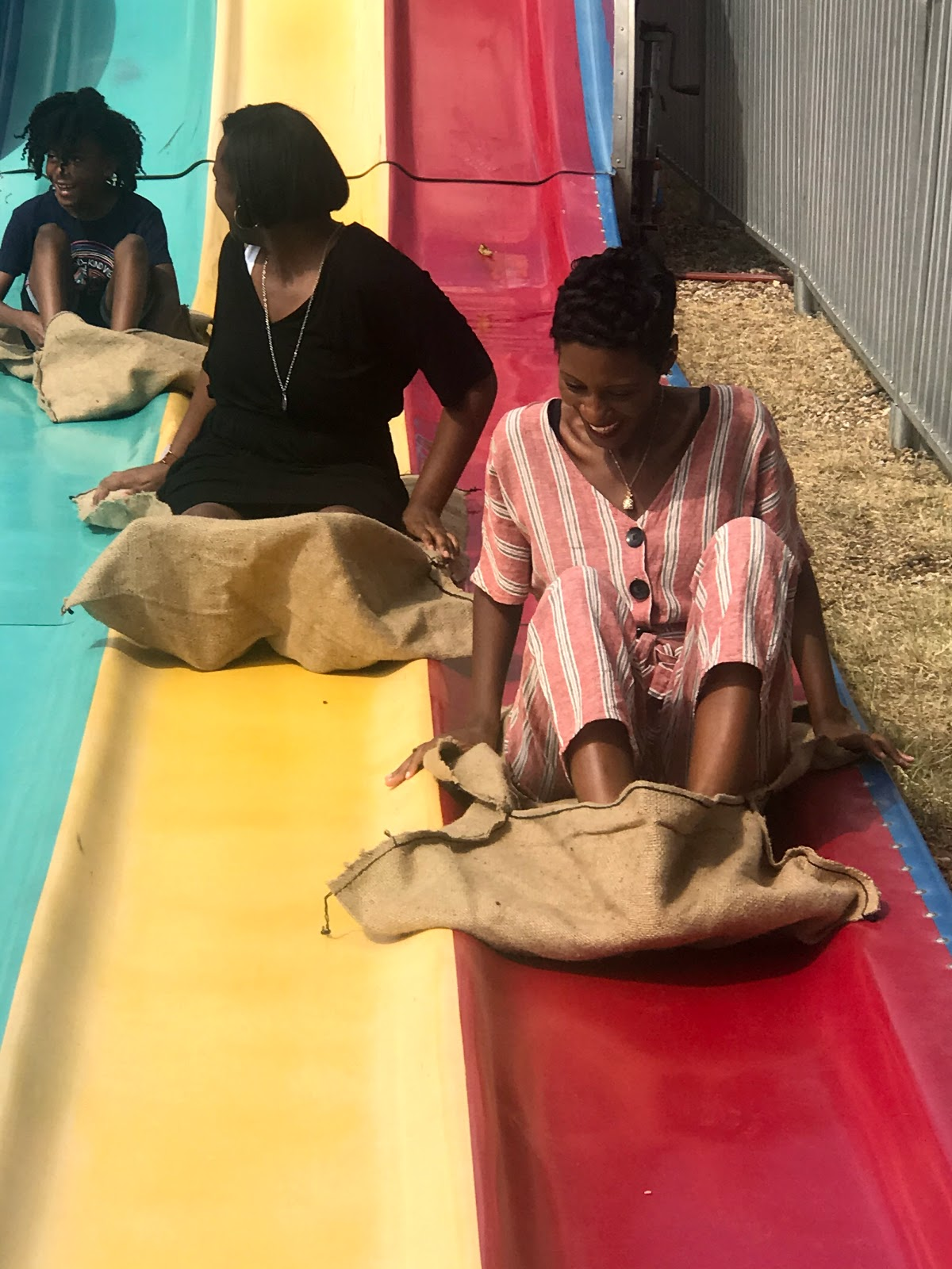 Image: Tangie Bell three daughters just got off slide at Octoberfest 2019 in Addison Texas. Family Day Out: Soaking Up The Sun, Eating Junk Food And Capping Off Summer's End!