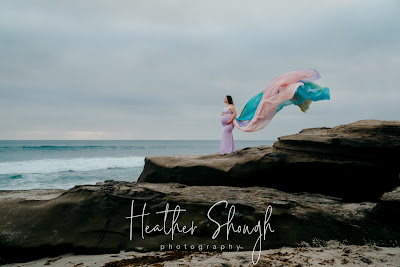 Portrait of a maternity rainbow mom at windandsea beach wearing chicaboo rainbow gown san diego