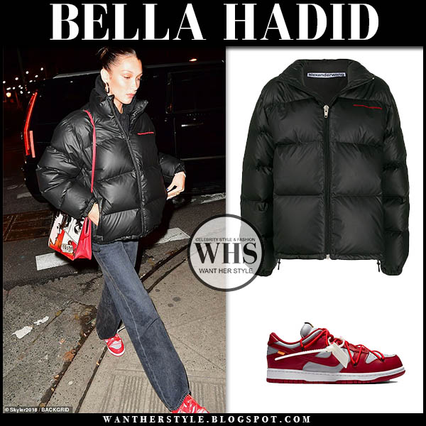 Bella Hadid in black Alexander Wang puffer jacket, black jeans and red Nike Off-White sneakers. Winter street style december 12