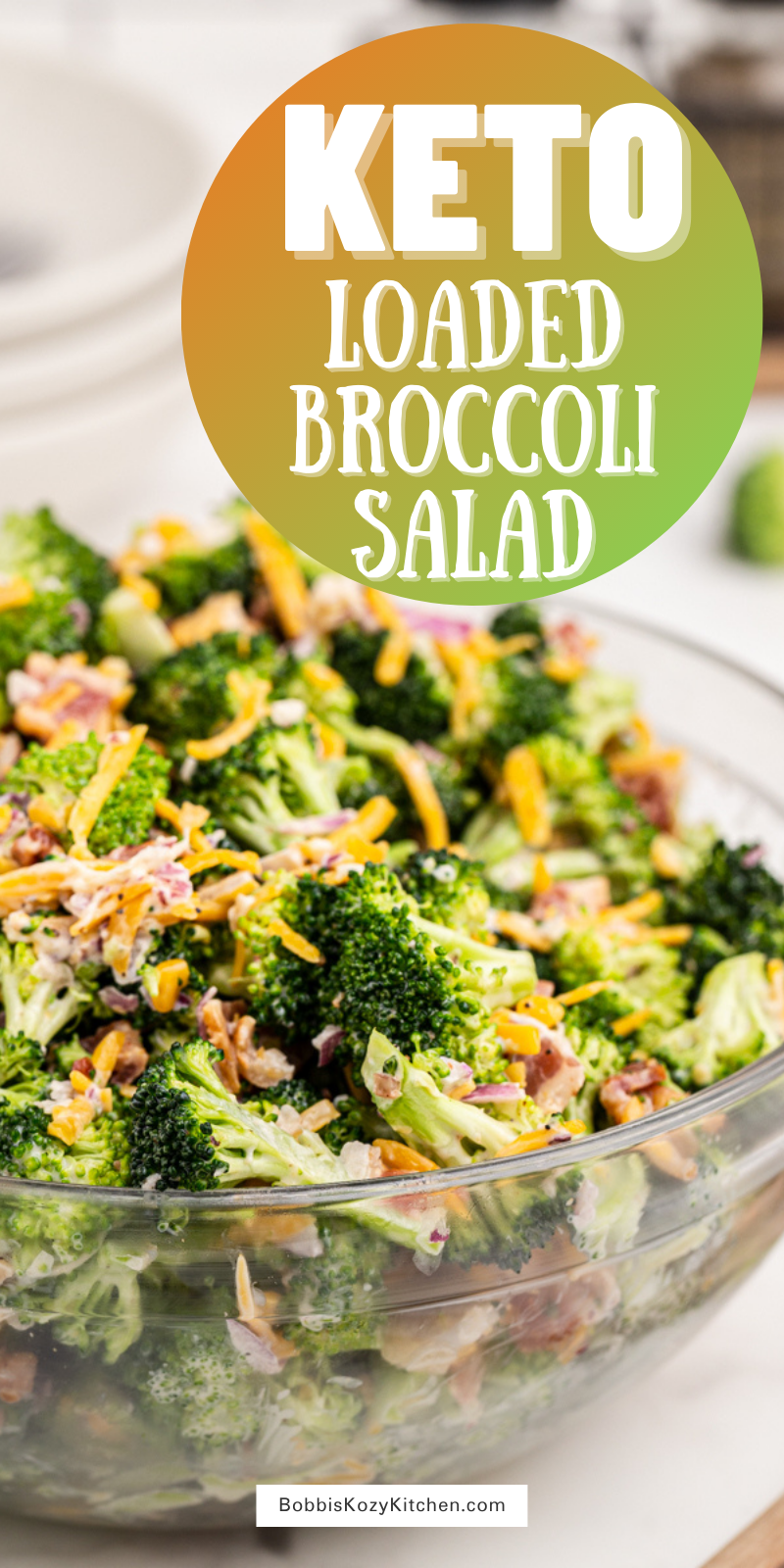 Loaded Broccoli Salad - This Loaded Broccoli Salad is the perfect low carb side dish. This delicious salad is filled with broccoli, bacon, red onion, cheese, and a homemade dressing your family will devour. #lowcarb #keto #broccoli #salad #bacon #cheese #onion