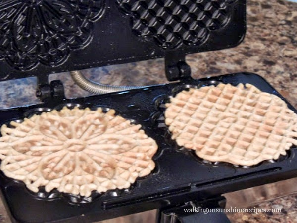 Pizzelle Cookies in waffle iron from Walking on Sunshine Recipes
