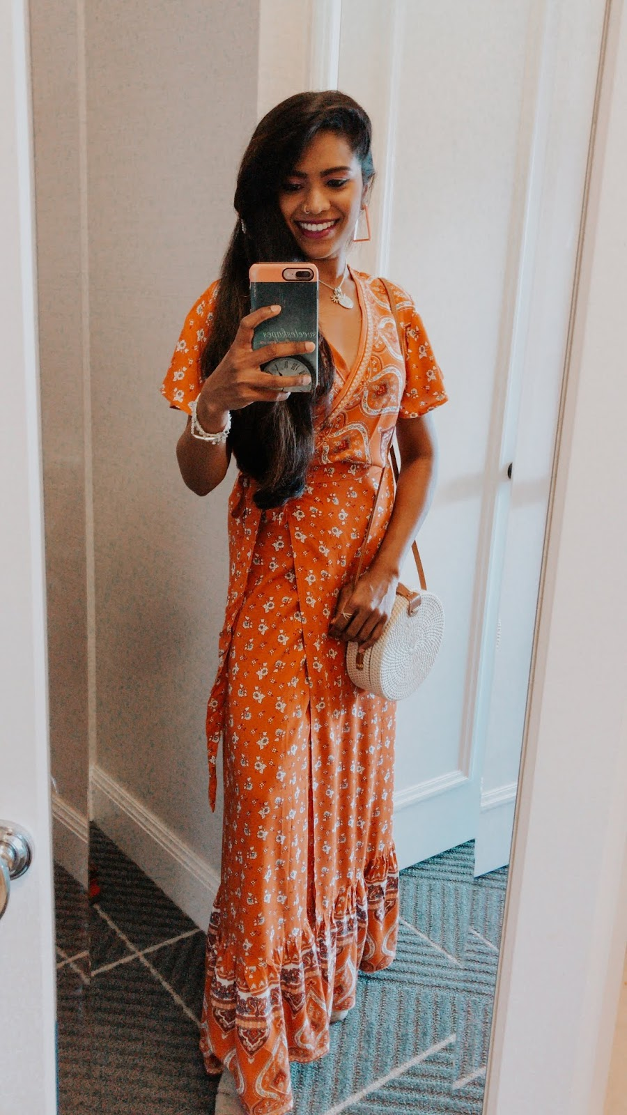 Current Favorites featured by top US fashion blog, Sveeteskapes: image of a woman wearing a Zesica wrap floral maxi dress