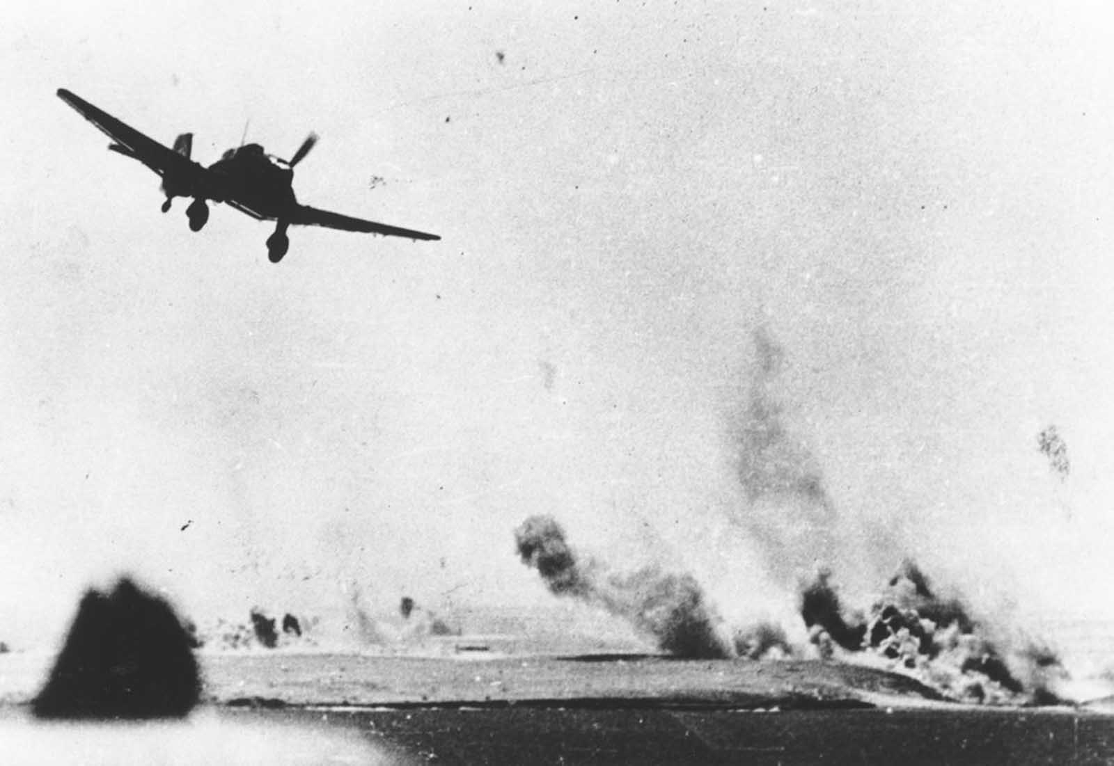 A German Junkers Ju 87 Stuka dive bomber attacking a British supply depot near Tobruk, Libya, in October of 1941.