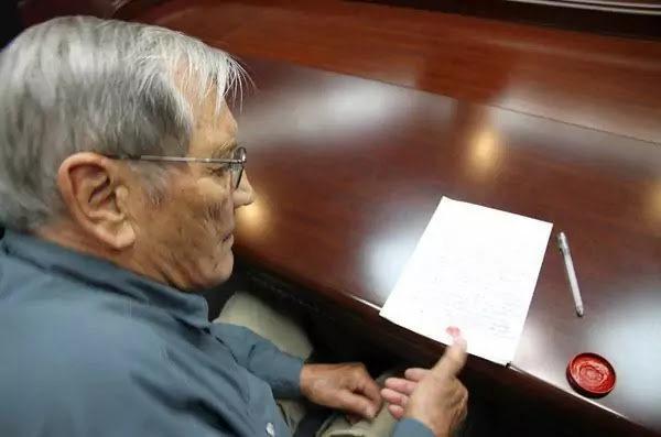 (1) US citizen Merrill E Newman in a photo released by KCNA