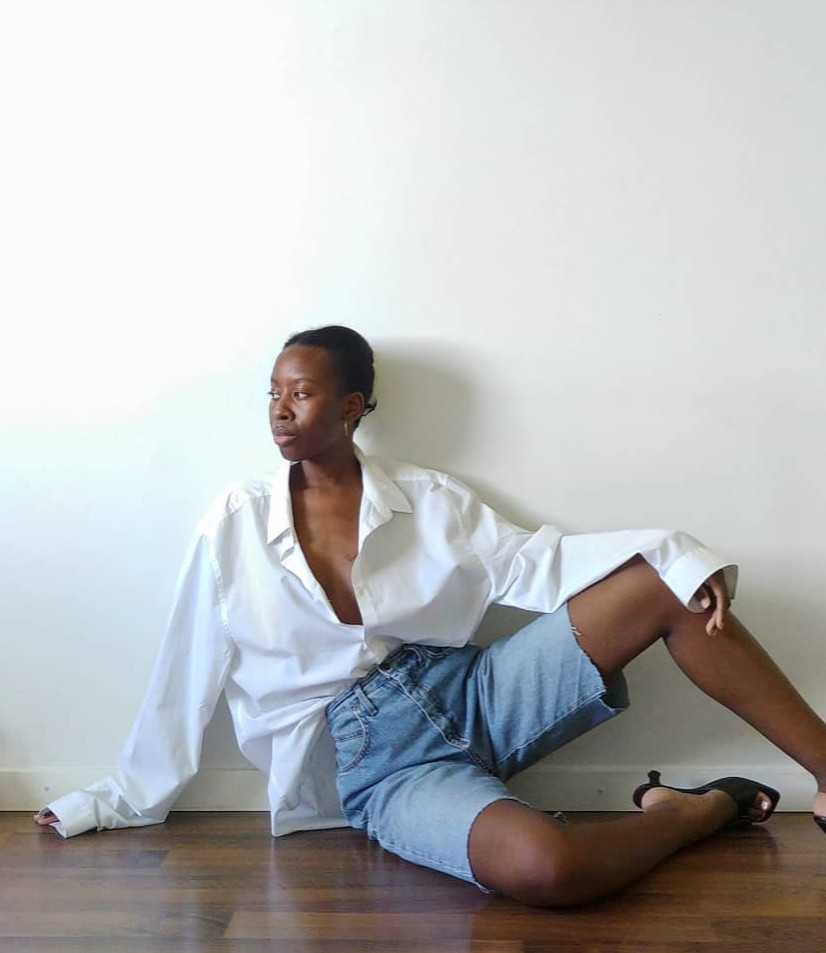 Effortless Outfit Idea — Sylvie Mus in an Oversized white button-down shirt, bermuda cut-off-denim shorts, and black mule heels