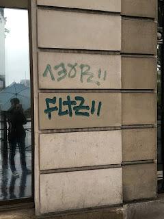 Graffiti on stonewall of buildings in Paris