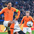 Van Dijk took time to console bereaved referee Ovidiu Hategan following the Netherlands 2-2 draw with Germany .