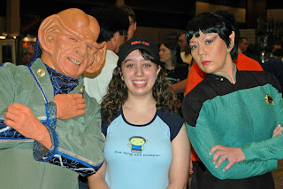 Teenager in between Star Trek cosplayers