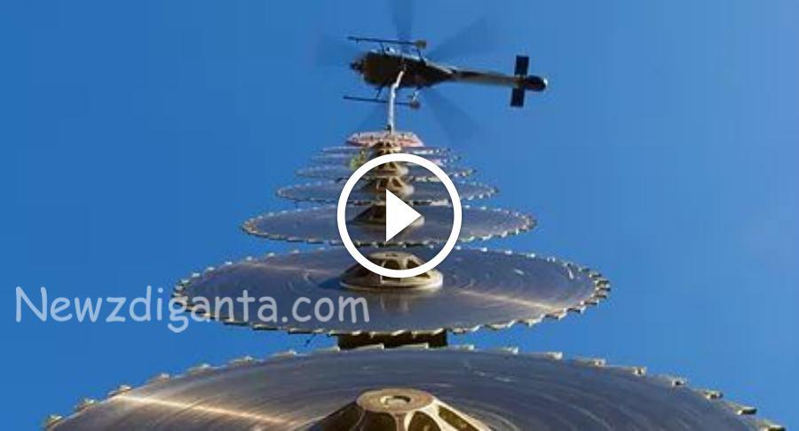 இது தெரியாம போச்சே ..Helicopter இல் இருந்து இப்படியும் மரம் வெட்டுவாங்களா !
