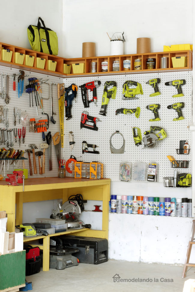 lots of tools on garage pegboard - yellow bench