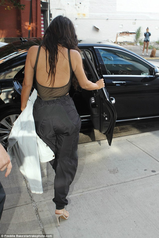 Kim Kardashian goes braless and sheer again in NY