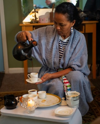 During her Ethiopian coffee ceremony Mrs. Berhe pours Ethiopian coffee