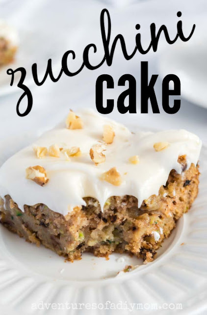 slice of zucchini cake with cream cheese frosting on a plate