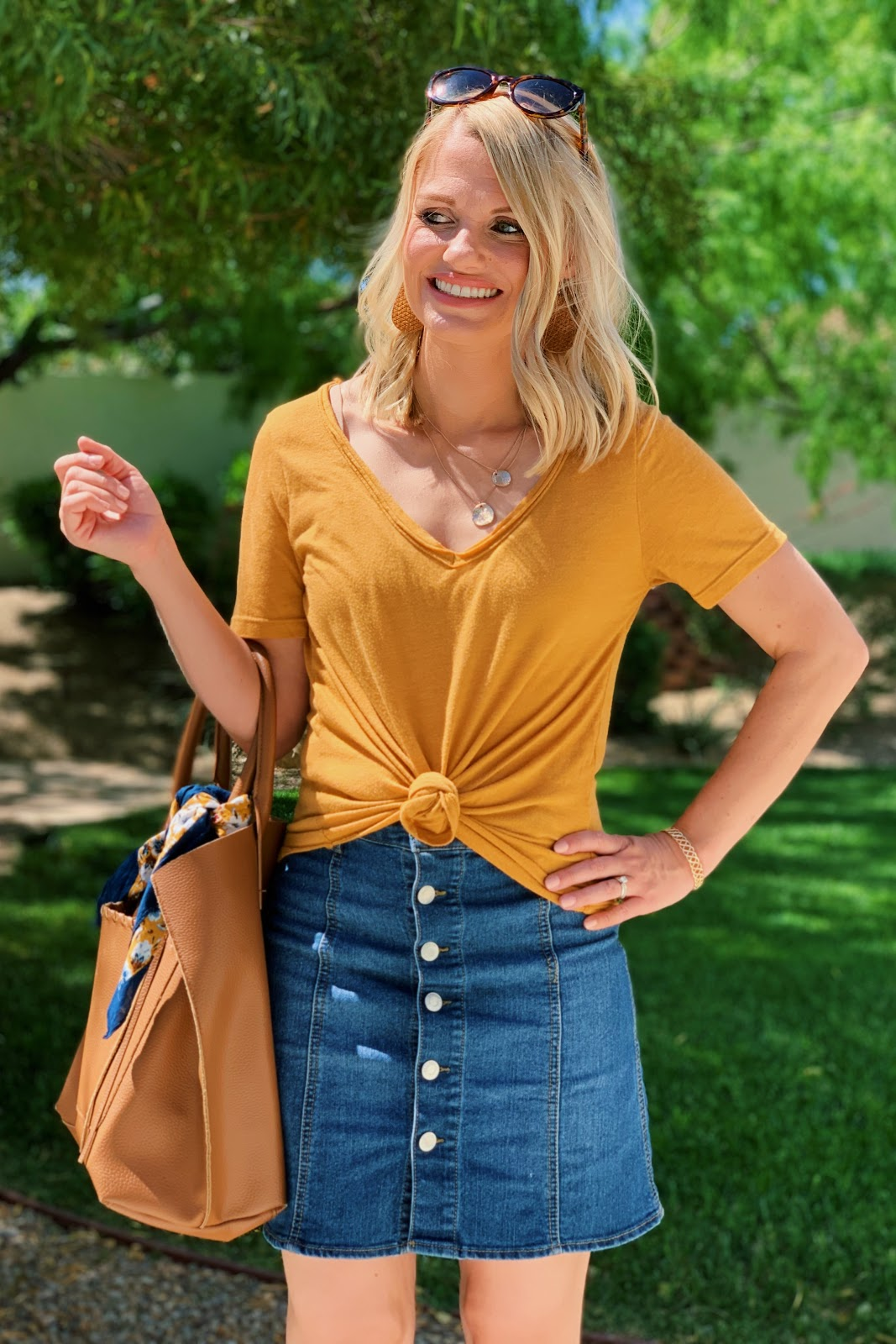 Yellow t-shirt with button front denim skirt