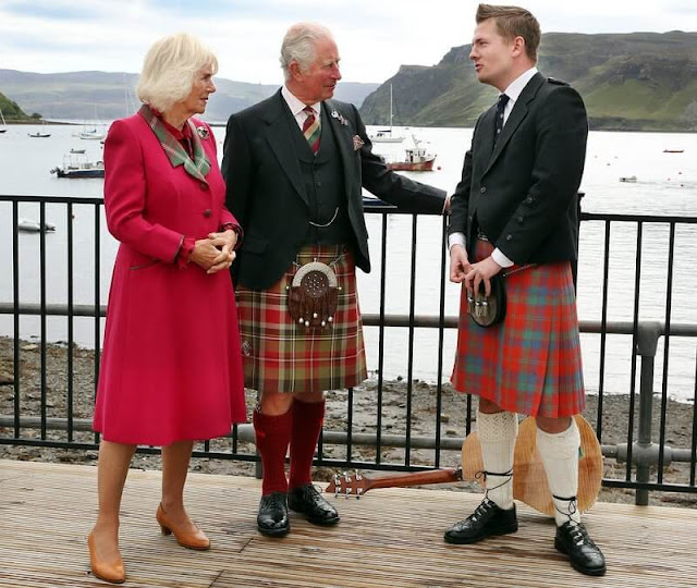 Duchess wore a waist-cinching red coat with a tartan lapel and tan heels. Camilla added a sapphire and diamond brooch