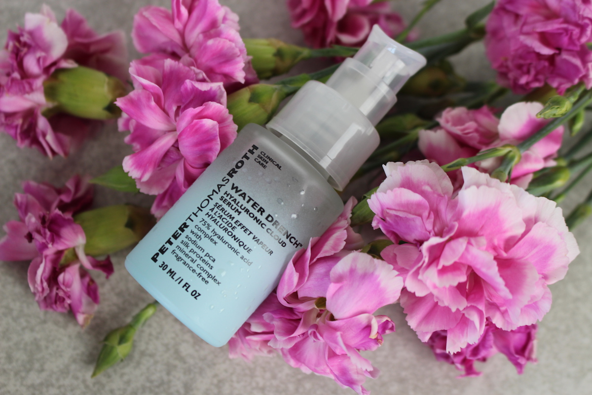 This is a close up of the Peter Thomas Roth Water Drench Serum and Moisturizer in a sea of pink flowers.
