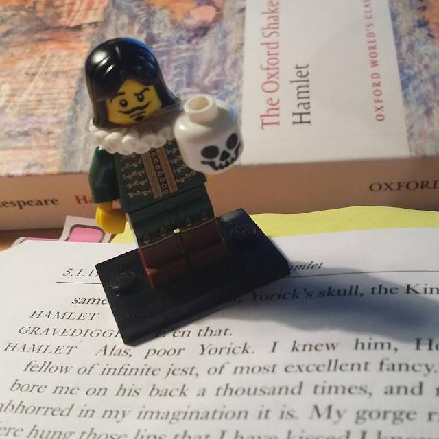 LEGO Hamlet standing on books
