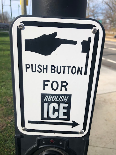 """Walk button with """"Abolish ICE"""" sticker placed so it now reads """"Push Button for Abolish ICE"""""""