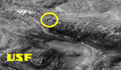 UFO on Mars and a structure on the side of a mountain that looks out of place.