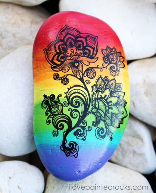 rock painting ideas with rainbow paint