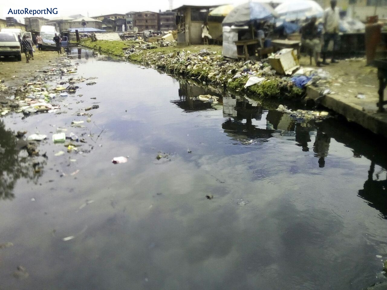 Flooded Jankara Market In Lagos Where Traders, Residents Wear Rain Boots To Work 8