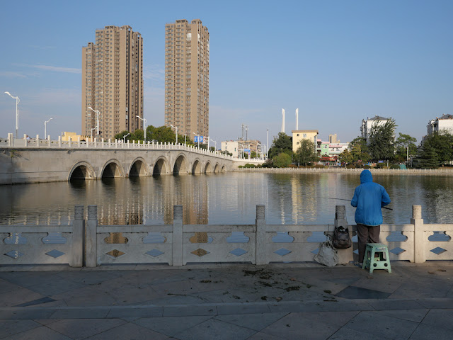 man fishing next to Heping Bridge in Xuzhou