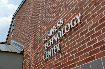 """Masonry building with name plate, reading """"Business Technology Center"""""""