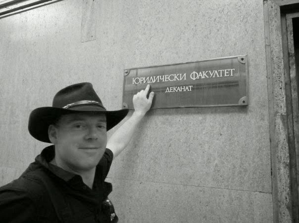 My husband pointing to a sign in Bulgarian at Sofia University.