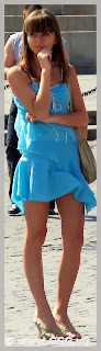 Girl in blue summer dress on the street