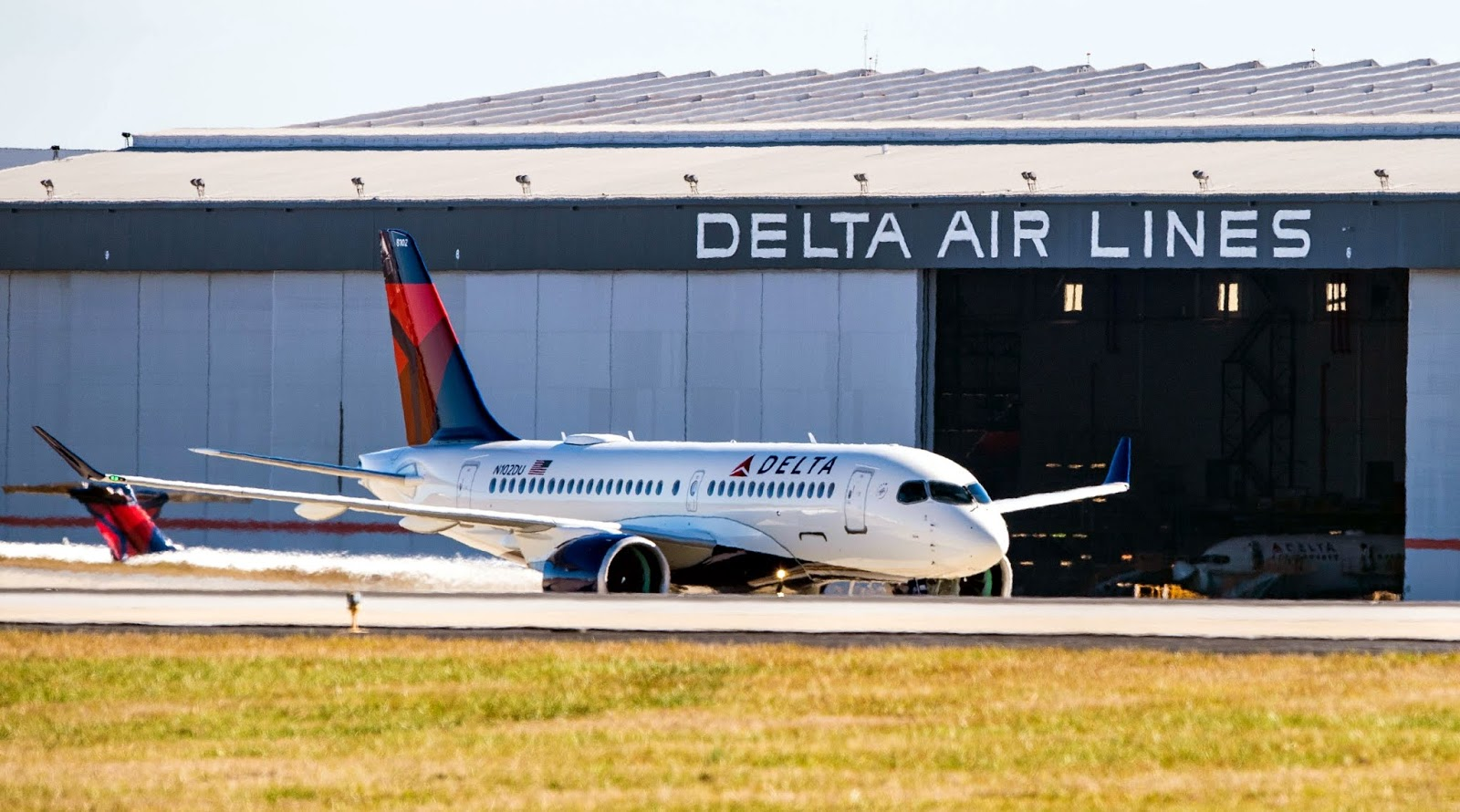 Delta Air Lines Airbus A220-100 In Front of Hangar
